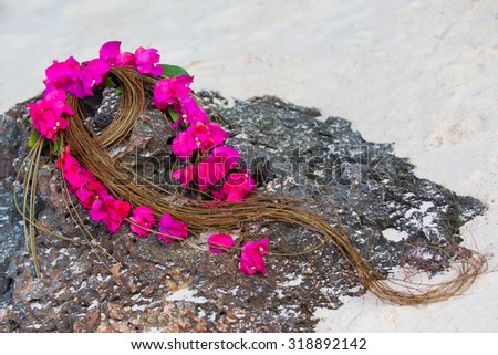 Wedding bouquet of the bride on a tropical beach . - stock photo