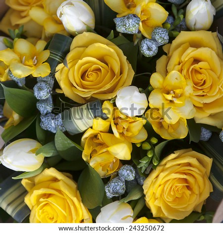 wedding bouquet of yellow flowers - anemone, rose and tulip - stock photo
