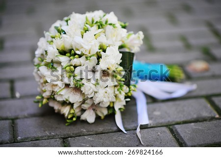Wedding bouquet on the pavement - stock photo