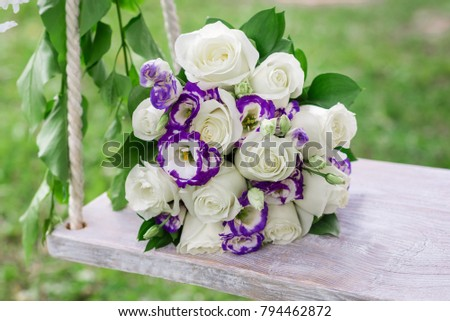 wedding bouquet on the swing
