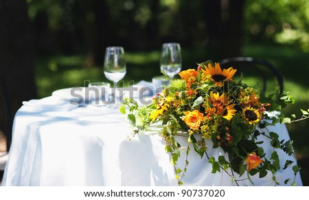 Wedding bouquet over white table outdoor. - stock photo