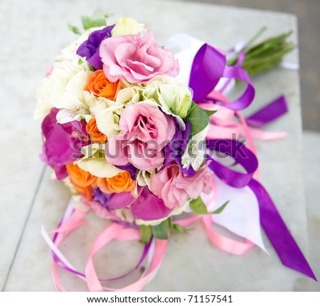 Wedding bouquet tied with silk ribbons - stock photo
