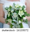 Wedding Bouquet with a bride in the background - stock photo