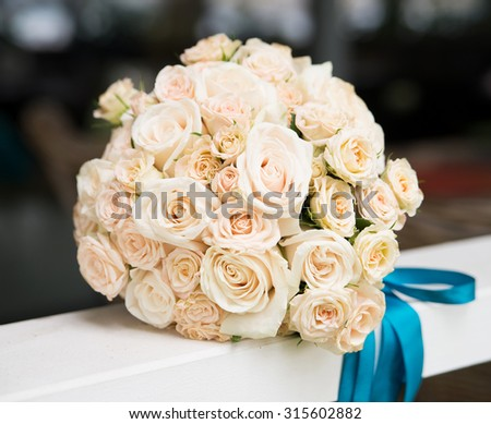 Wedding bouquet with ivory, beige roses