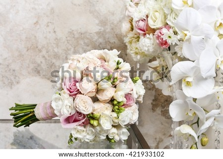Wedding bouquet with roses and freesias.
