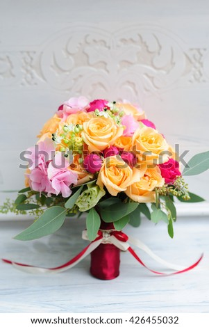 Wedding bouquet with roses and orchids on the white background - stock photo