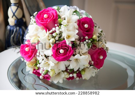 Wedding bouquet with roses on table