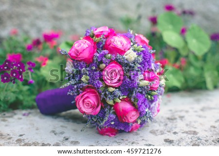Wedding bouquet with violet flowers on nature background. wedding concept
