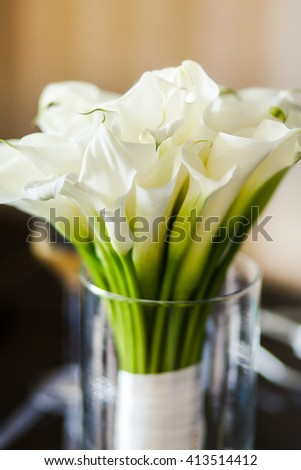 Wedding bouquet with white callas in the vase