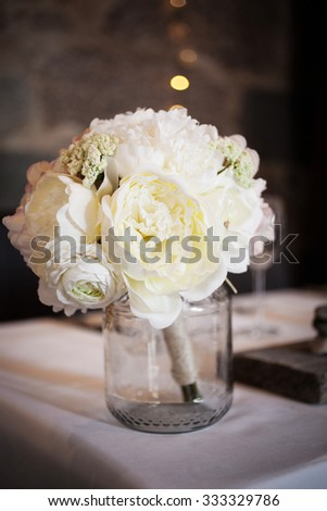 Wedding bouquet with white peonies on table - stock photo