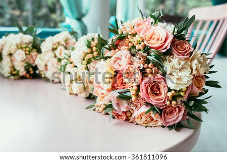 Wedding bouquets of bride and bridesmaids on table before ceremony starting
