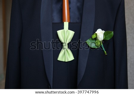 Wedding boutonniere on suit of groom  - stock photo