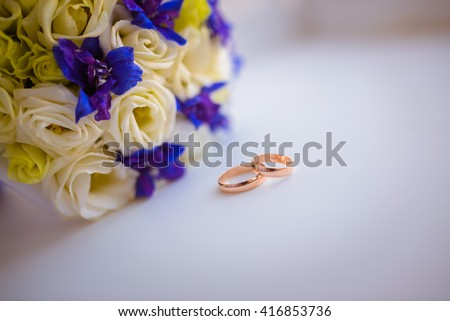 Wedding Bridal bouquet colorful flowers, pink, White roses and yellow freesia, lying on the table - stock photo