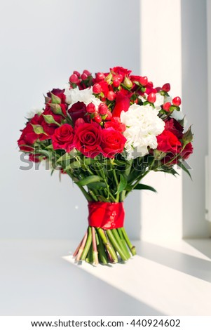 wedding bridal bouquet from red roses and berries on a white background - stock photo