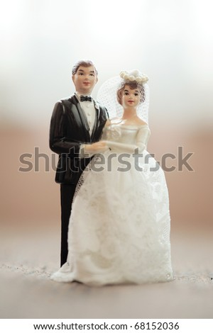 wedding bride and groom couple doll with blur background - stock photo