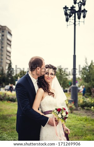 wedding. Bride and groom hugging in the city - stock photo