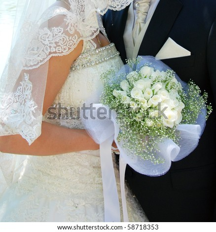 wedding - bride and groom - roses - stock photo