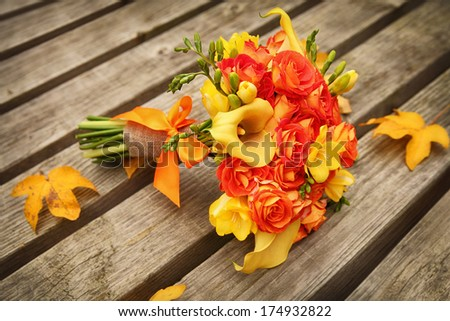 wedding bunch on old wooden table - stock photo