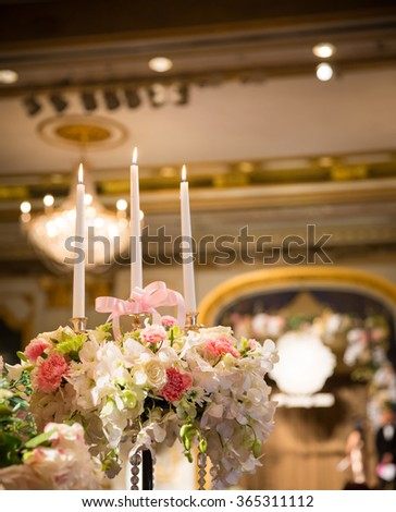 Wedding cake and candle with flower decorate - stock photo