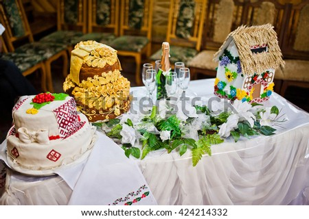 Wedding cake and champagne on small wedding table - stock photo
