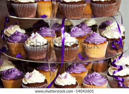 Wedding Cake - Bunch of Yummy Traditional Colorful Chocolate Cupcakes - stock photo