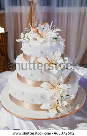 Wedding Cake with Flowers and Ribbons