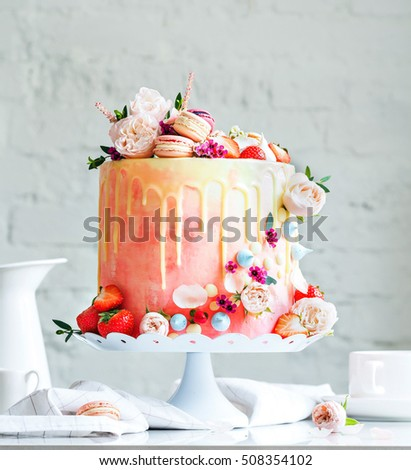 Wedding cake with flowers macarons and blueberries