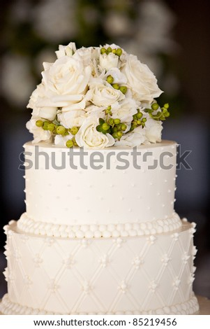 Wedding Cake with Flowers on Top - stock photo