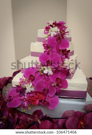 Wedding Cake with red orchids - stock photo