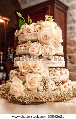 Wedding cake with roses - stock photo
