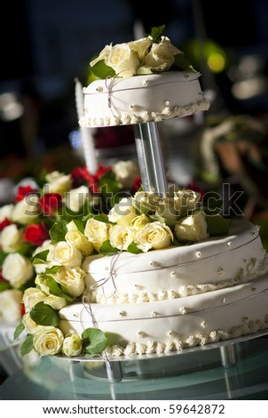 Wedding cake with roses - stock photo