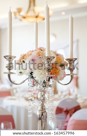 Wedding candlestick with flower decoration  - stock photo