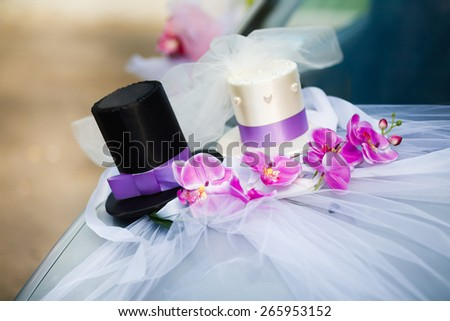Wedding car decoration with black and white top hats - stock photo