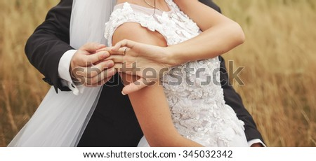 Wedding caucasian couple together. Happy newlyweds. Groom and bride walking together.  - stock photo