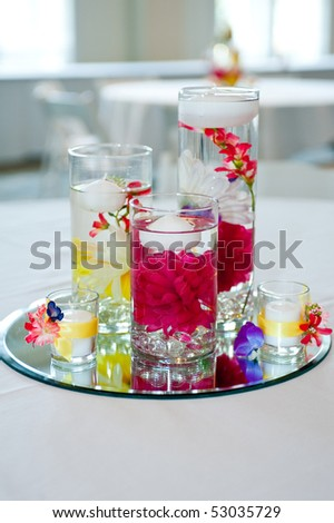 wedding centerpiece with floating candles and flowers - stock photo