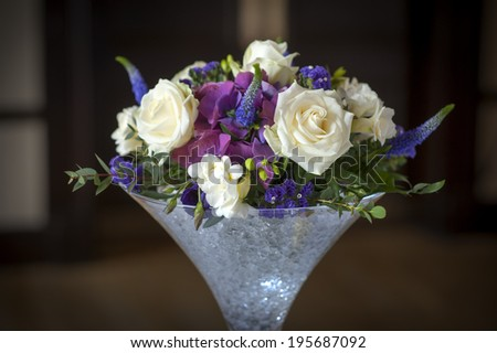 wedding centrepiece flowers white and purple - stock photo