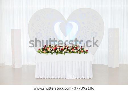 Wedding ceremony decoration in the restoraunt. Decoration of wedding table - stock photo