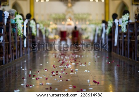 Wedding ceremony in church - out of focus - stock photo