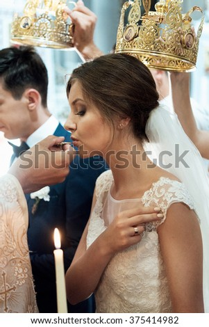 wedding ceremony of stylish elegant  bride and groom in the  church, Communion - stock photo