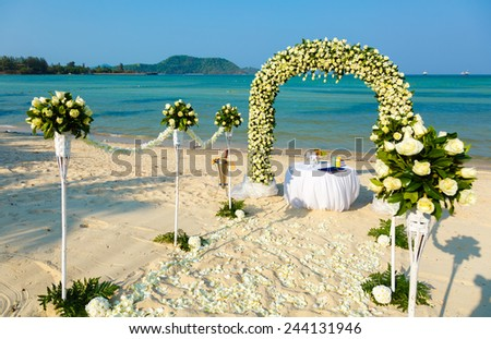 Wedding ceremony on a beach by the sea - stock photo
