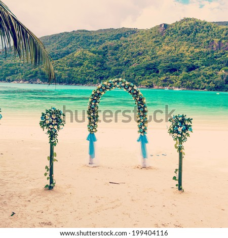 wedding ceremony on the beach, the details of design, bouquet of frangipani - stock photo