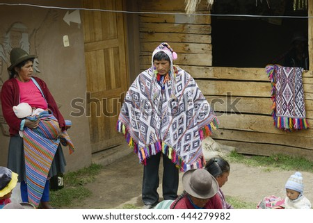 Wedding ceremony preparaton. View of the bride`s father wearing handwoven poncho and chullo - knitted hat with earflaps, Paru Paru, Andes Mountain.  October 22, 2012 - Paru Paru, Peru - stock photo