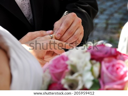 wedding ceremony with groom and bride and beautiful flower - stock photo