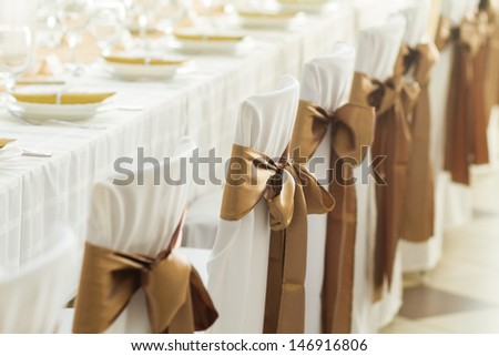 wedding chairs with silk ribbon - stock photo