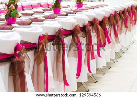 wedding chairs with silk ribbons - stock photo