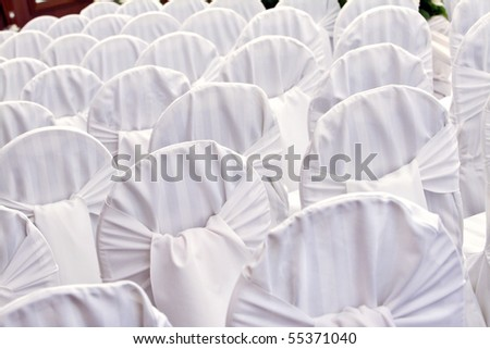 wedding chairs with the white covers - stock photo