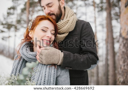 Wedding couple close-up. Bride and groom on the background of a winter landscape - mountains and forest with snow