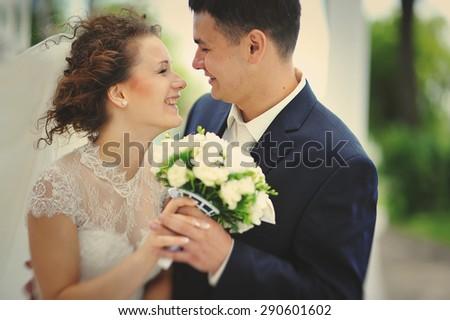 wedding couple close up embrace and smile - stock photo