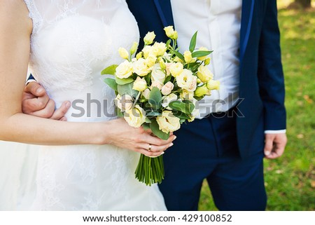 Wedding couple details. No face, only body and hands.