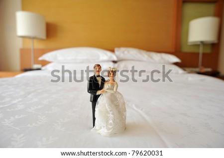 wedding couple doll in bedroom - stock photo